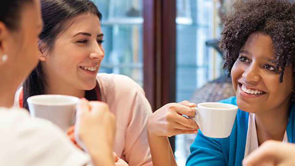 Women chatting over coffee